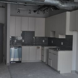 The kitchen in a one-bedroom unit.