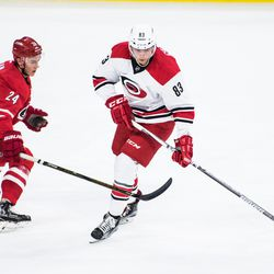 Jake Bean defends David Cotton. July 1, 2017. Carolina Hurricanes Summerfest and Development Camp, PNC Arena, Raleigh, NC. Copyright © 2017 Jamie Kellner. All Rights Reserved.