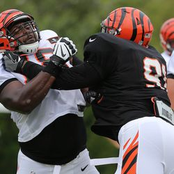 Cincinnati Bengals offensive guard Kent Perkins (78), left, blocks defensive tackle Marcus Hardison (91), right, during Cincinnati Bengals training camp practice on the practice fields at Paul Brown Stadium.