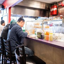 Everyone sits front and center at Taco Ssam. <br>