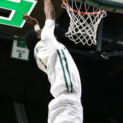 Tim Bond attempting to lay down a dunk<br>