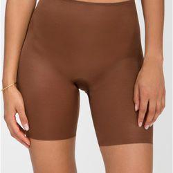 """Spanx <a href=""""http://www.spanx.com/shapewear/mid-thighs?AB=mm_fncat_spx_shrt_styl_mt"""">Skinny Britches Mid-Thigh Short</a>, $48"""