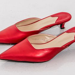 """Loeil <a href=""""https://theloeil.com/collections/shoes/products/jaclyn-slingback-mules-red"""">Jaclyn Slingback Mules</a>, $72"""
