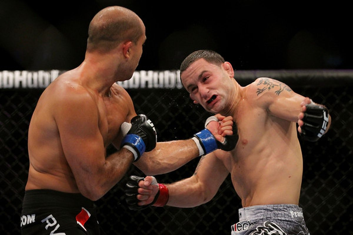 10 of the biggest overhyped mma fighters of all time - Boston August 28 Bj Penn L Connect With A Punch To The Face Of Frank Edgar During Their Ufc 118 Lightweight Title Bout At The Td Garden On August 28