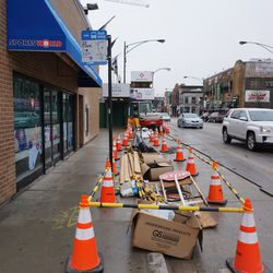 Utility work being done along Clark Street, just south of Addison Street