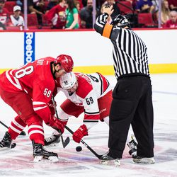 Opening faceoff - Nicolas Roy vs. Janne Kuokkanen. July 1, 2017. Carolina Hurricanes Summerfest and Development Camp, PNC Arena, Raleigh, NC. Copyright © 2017 Jamie Kellner. All Rights Reserved.