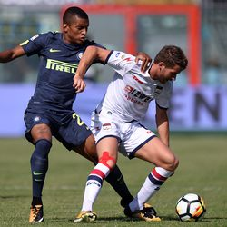 Henrique Dalbert (L) of Internazionale and Marcus Christen Rohden of Crotone compete for the ball during the Serie A match between FC Crotone and FC Internazionale at Stadio Comunale Ezio Scida on September 16, 2017 in Crotone, Italy.