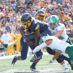 A Toledo player getting wrapped up by the Eastern Michigan defense.<br>