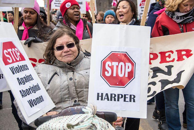 Women protest then-Prime Minister Stephen Harper on International Women's Day in Toronto in 2015