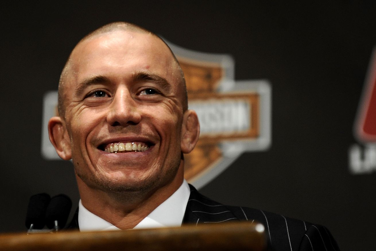 Sorry Canada, but Georges St Pierre is getting his face beat in by Johny Hendricks