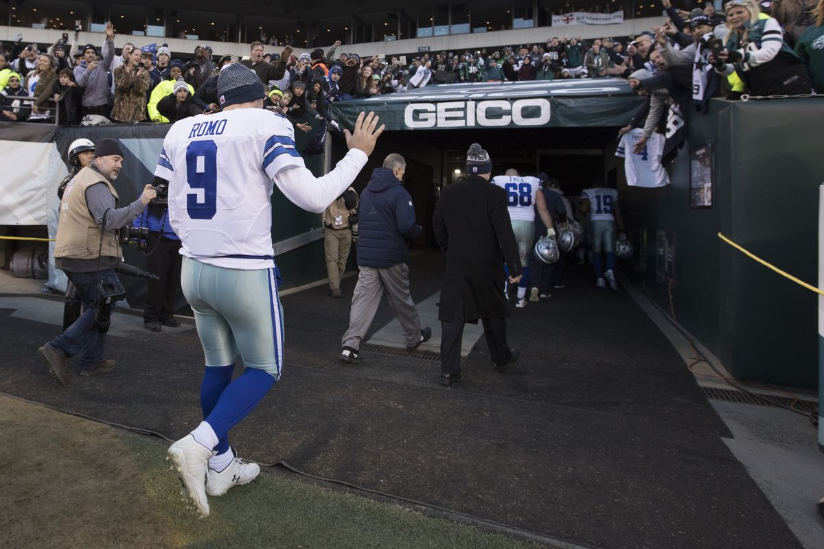 Cowboys' Romo leaving the field for the broadcast booth