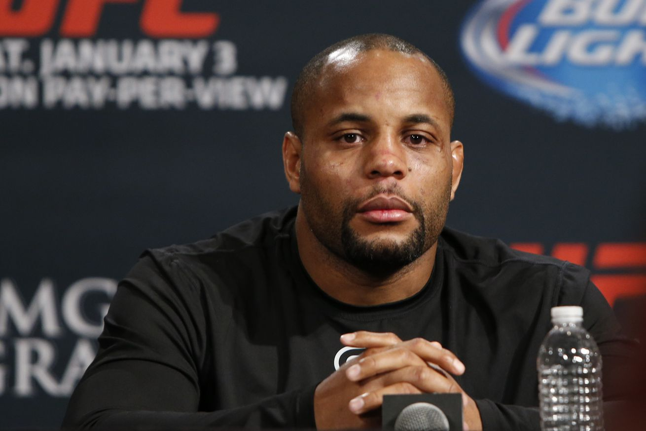 community news, Daniel Cormier not thrilled to find himself being dwarfed by Anthony Johnson on UFC 210 poster