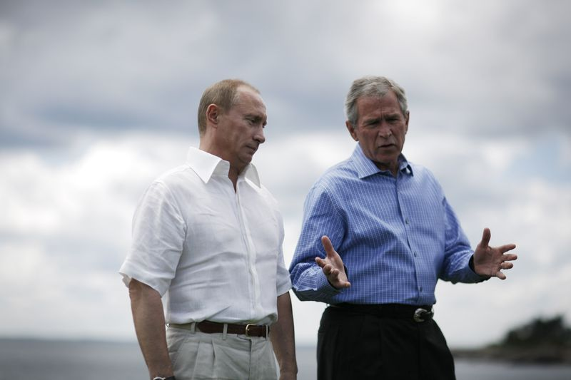 Putin visits then-President George W. Bush at his family's home in Maine (Charles Ommanney/Getty)