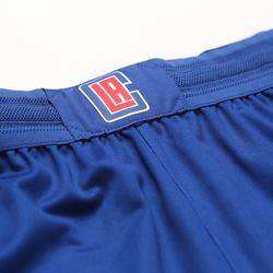 """View of the waistband of the Clippers' new blue """"Icon edition"""" jersey by Nike, featuring a Clippers logo."""