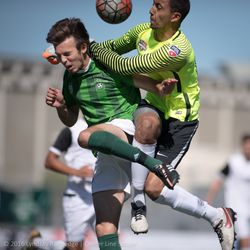 Danny Musovski goes for a header for the Burlingame Dragons.