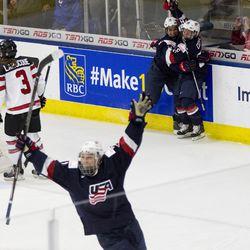 Team USA forward Hilary Knight, Team USA forward Brianna Decker, and Team USA forward Kendall Coyne celebrate Knight's game winning goal in overtime.