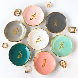 """Modern Mud <a href=""""https://www.etsy.com/listing/479263597/gold-monogrammed-ring-dish-personalized?ref=finds_l"""">Ring Dish</a>, $40"""