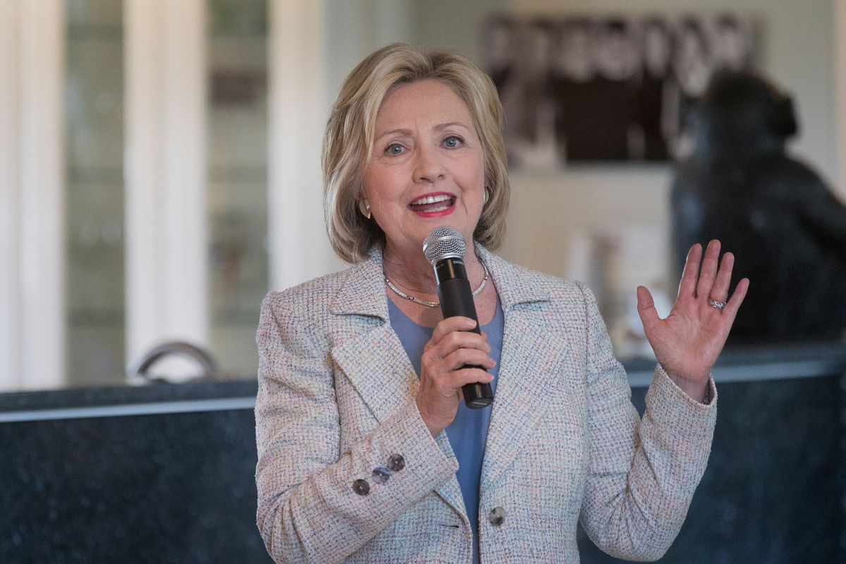 hillary clinton s college affordability plan explained vox clinton speaks in iowa in scott olson getty images
