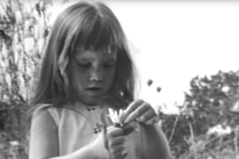 A little girl plucks the petals of a daisy in a campaign ad run by Lyndon B. Johnson in 1964