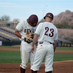 Freshman Lyle Lin adjusting his belt after notching his first single of the year