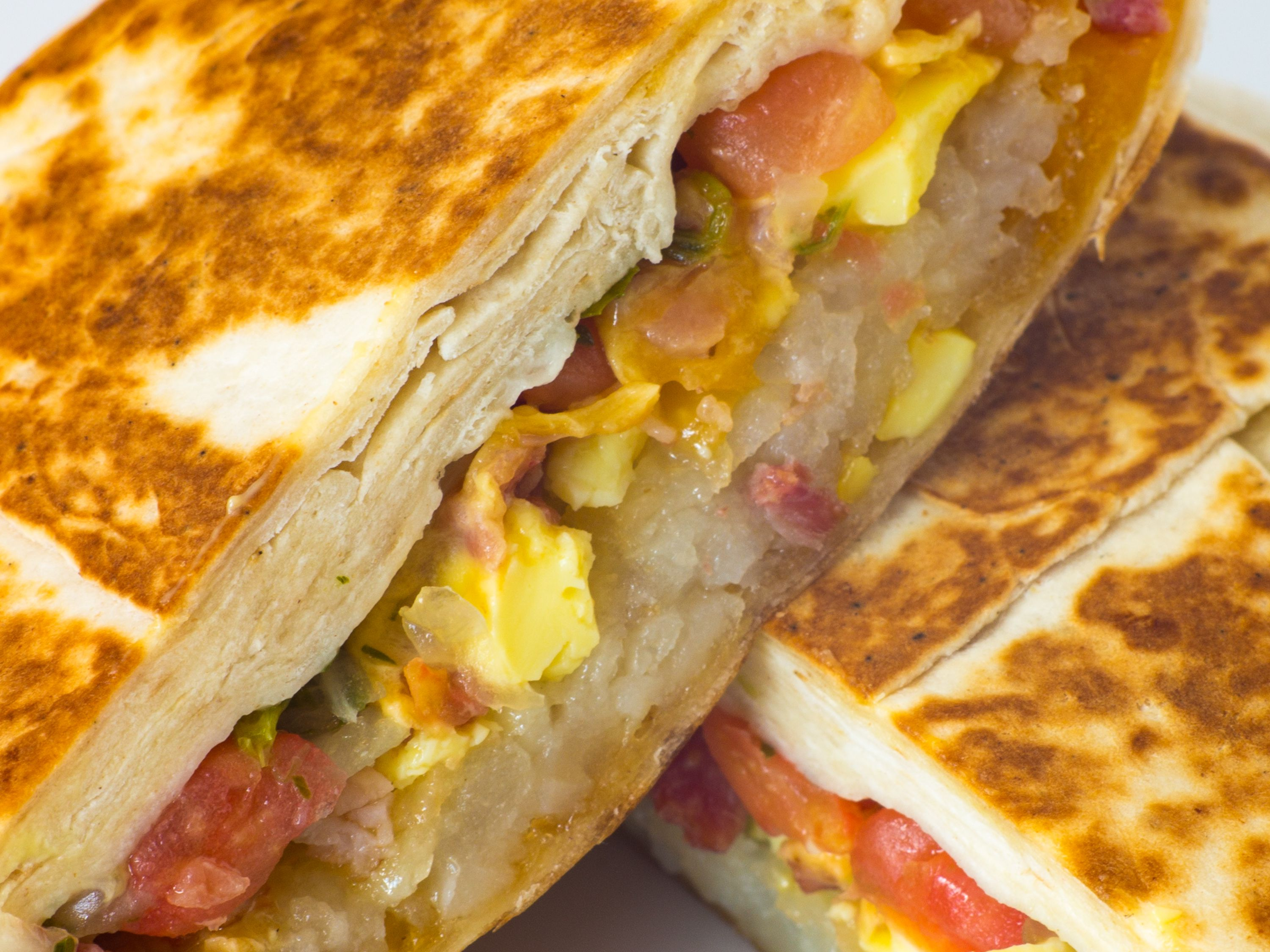 taco bell s breakfast menu ranked eater whole hash browns stuffed into a hexagonal quesadilla eggs cheese and bacon here taco bell is effectively appropriating a low level breakfast
