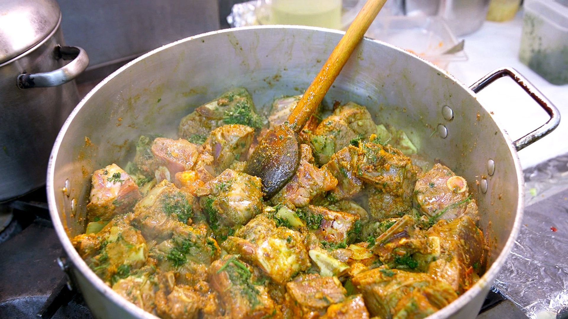 watch sampling an aromatic trinidadian goat curry in seattle eater - Pams Kitchen