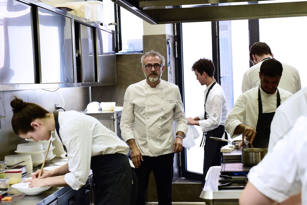 the world s best restaurants get by a lot of unpaid labor massimo bottura and staff in the osteria scana kitchen photo giuseppe cacace afp getty images