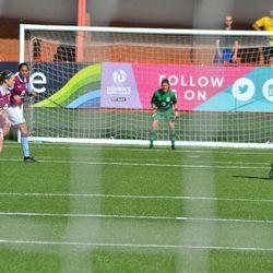 Aston Villa keeper Claire Skinner as seen through the away net.