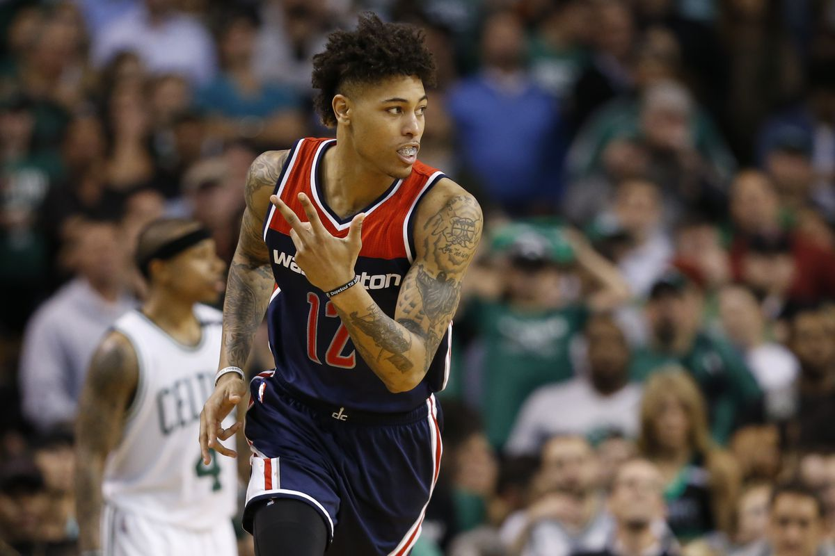 Wizards forward Oubre ejected for bowling over Olynyk