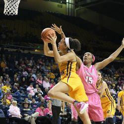 Tinara Moore driving to the basket.<br>