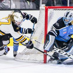 Buffalo Beauts Goaltender Brianne McLaughlin makes a save on a gorgeous wrap around attempt by Boston Pride's Meghan Duggan.