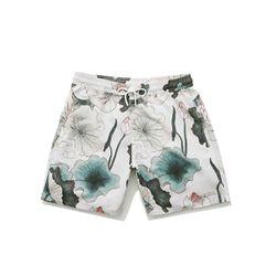"Saturdays NYC <a href=""https://www.saturdaysnyc.com/item/timothy-lotus-swim-shorts-lotus-print"">Lotus Print Board Shorts</a>, $85"