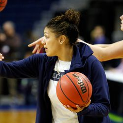 UConn assistant coach Marisa Moseley gives instruction in a drill during their Sweet 16 practice.<br>