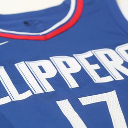 """View of the """"Clippers"""" wordmark on the team's new blue """"Icon edition"""" jersey designed by Nike.  The previous lines underneath the wordmark have been removed."""