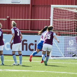 Claire Skinner collects the ball against Brighton and Hove Albion.