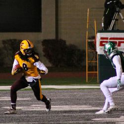 Corey Willis eludes an Eastern Michigan defender after a catch.<br>