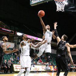 Ty Toney flying towards the basket<br>