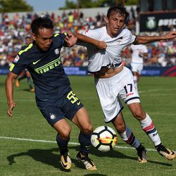 Yuto Nagatomo (L) of Internazionale and Ante Budimir of Crotone compete for the ball during the Serie A match between FC Crotone and FC Internazionale at Stadio Comunale Ezio Scida on September 16, 2017 in Crotone, Italy.