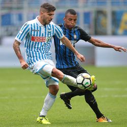 Alberto Paloschi of Spal (L) competes for the ball with Henrique Dalbert of FC Internazionale Milano during the Serie A match between FC Internazionale and Spal at Stadio Giuseppe Meazza on September 10, 2017 in Milan, Italy.