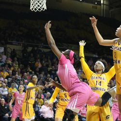 A Toledo player getting tripped up on her way to the basket.<br>