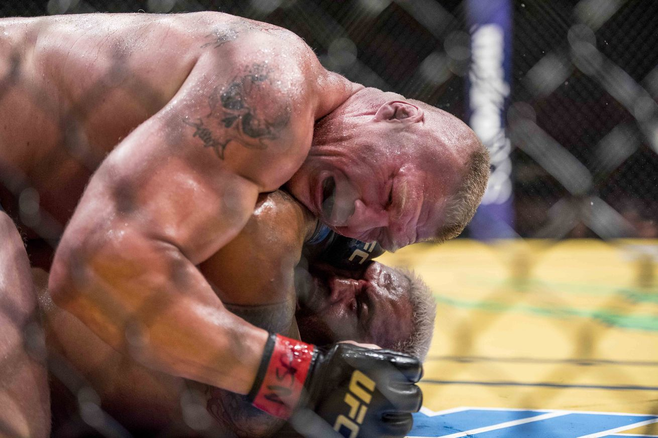 community news, Midnight Mania! Brock Lesnar's wrist slap, UFC's suburban sprawl and brawl