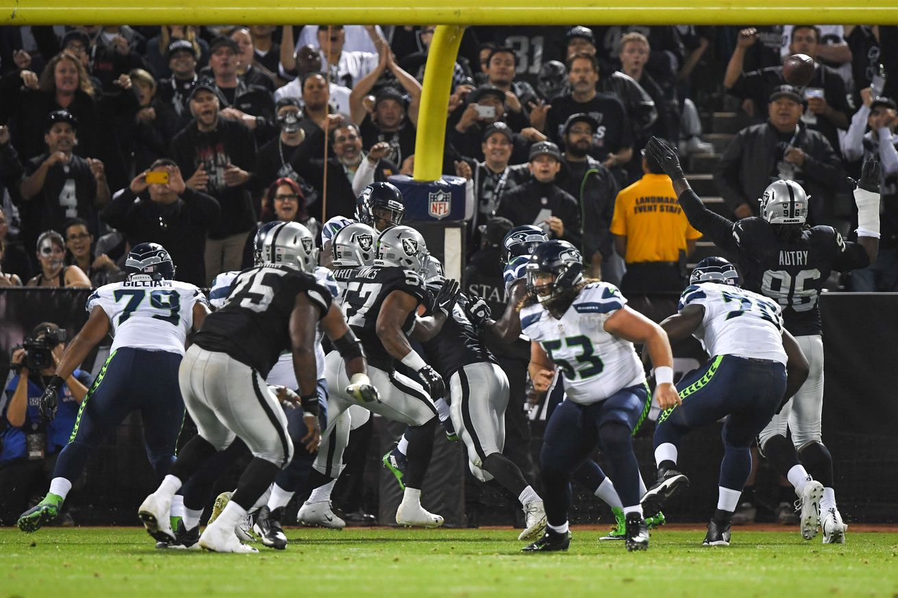 Seahawks close exhibition season with 23-21 win over Raiders
