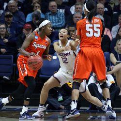 UConn's Saniya Chong (12) tries to work through a Syracuse screen.