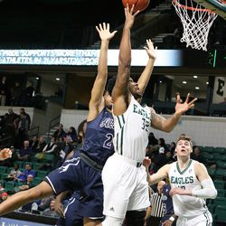Ty Toney charges the basket.<br>