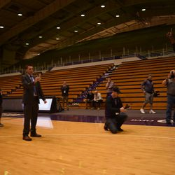 Northwestern assistant coach Armon Gates bounds on to Welsh-Ryan Arena as he's introduced.