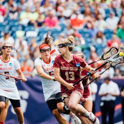 Laura Frankenfield tries to run past Maryland's defense