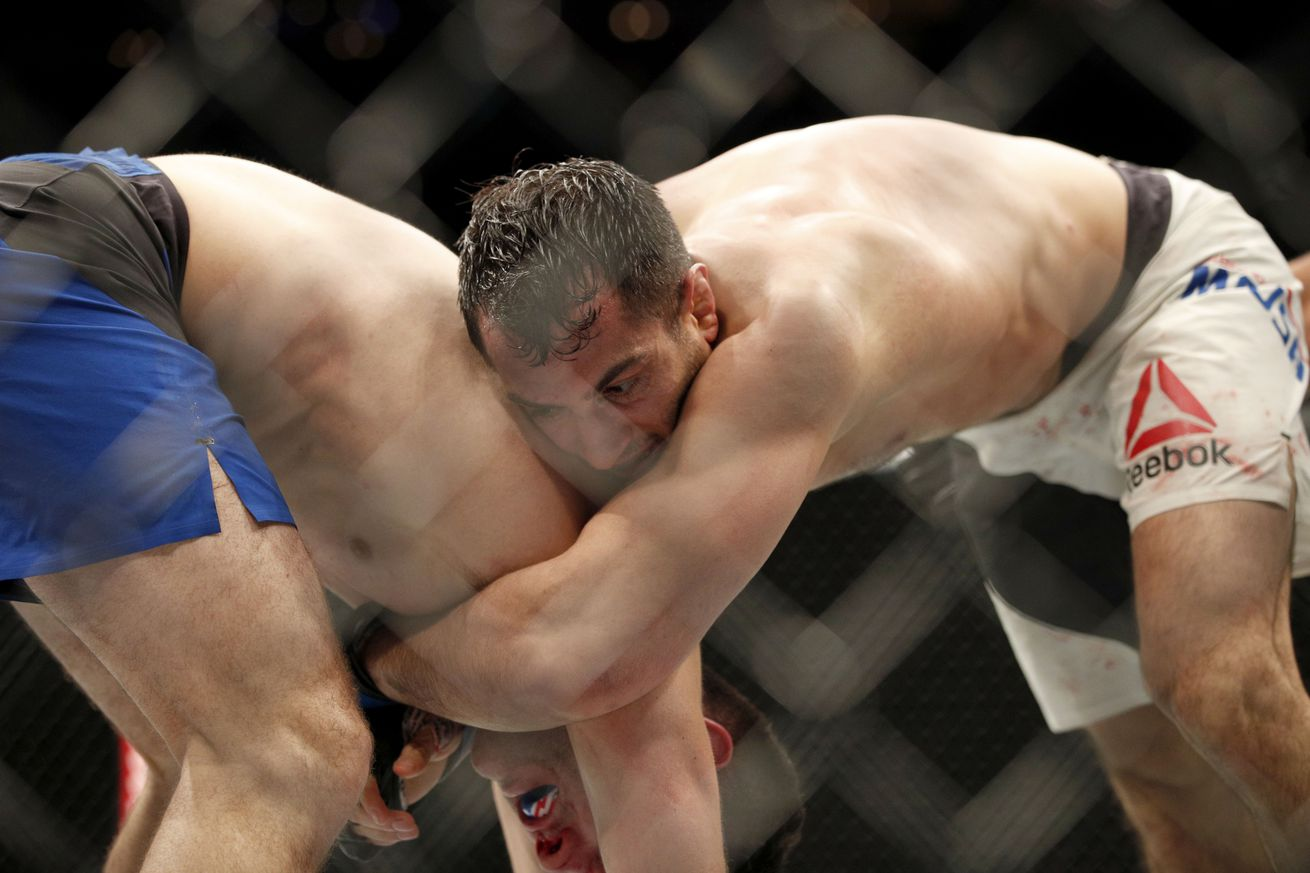 community news, Gegard Mousasi lands legal knee on Chris Weidman in controversial UFC 210 win