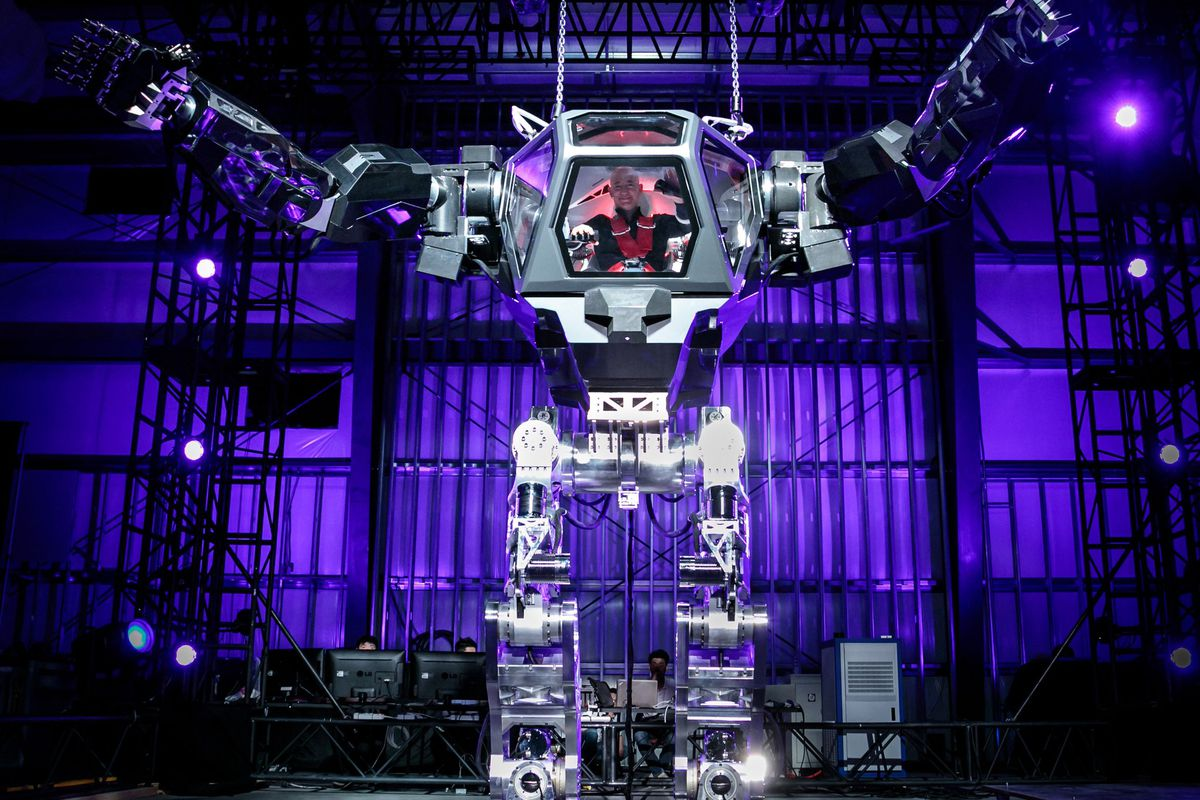 CEO Jeff Bezos pilots 13-foot mech at Amazon conference