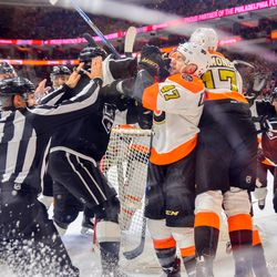 A scrum behind the Flyers net during the second period