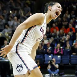 UConn's Kia Nurse (11) celebrates after making her seventh three-pointer of the first half.